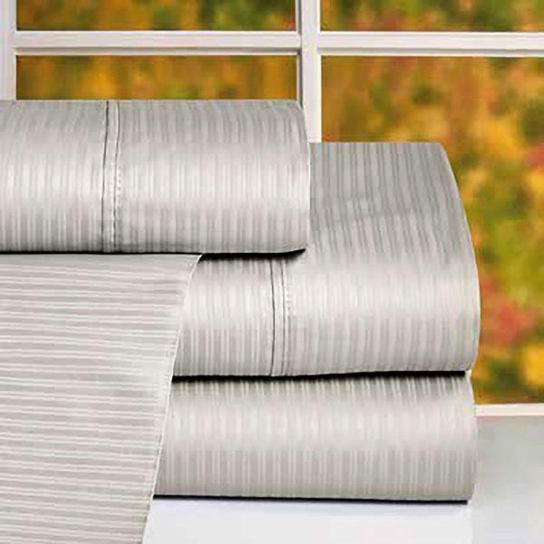 sabanas dobladas de algodón color gris