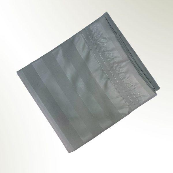 Funda de almohada doblada en rectangulo gris